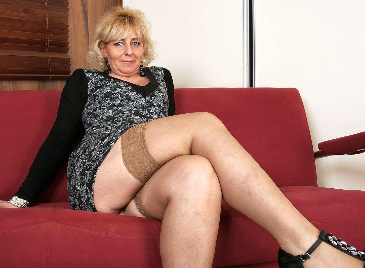 Horny mature woman in red stockings masturbates