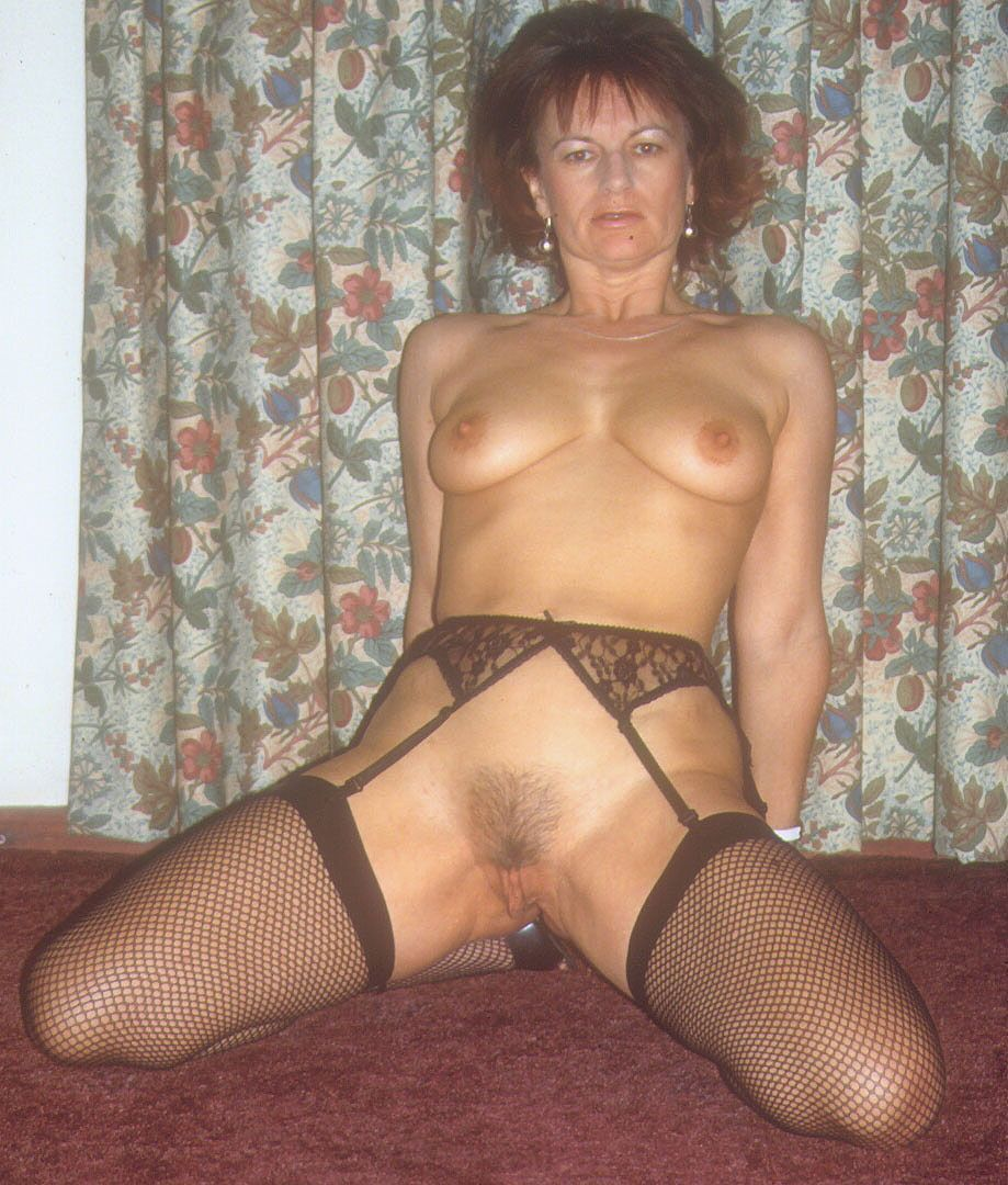 Wife in stockings and suspenders