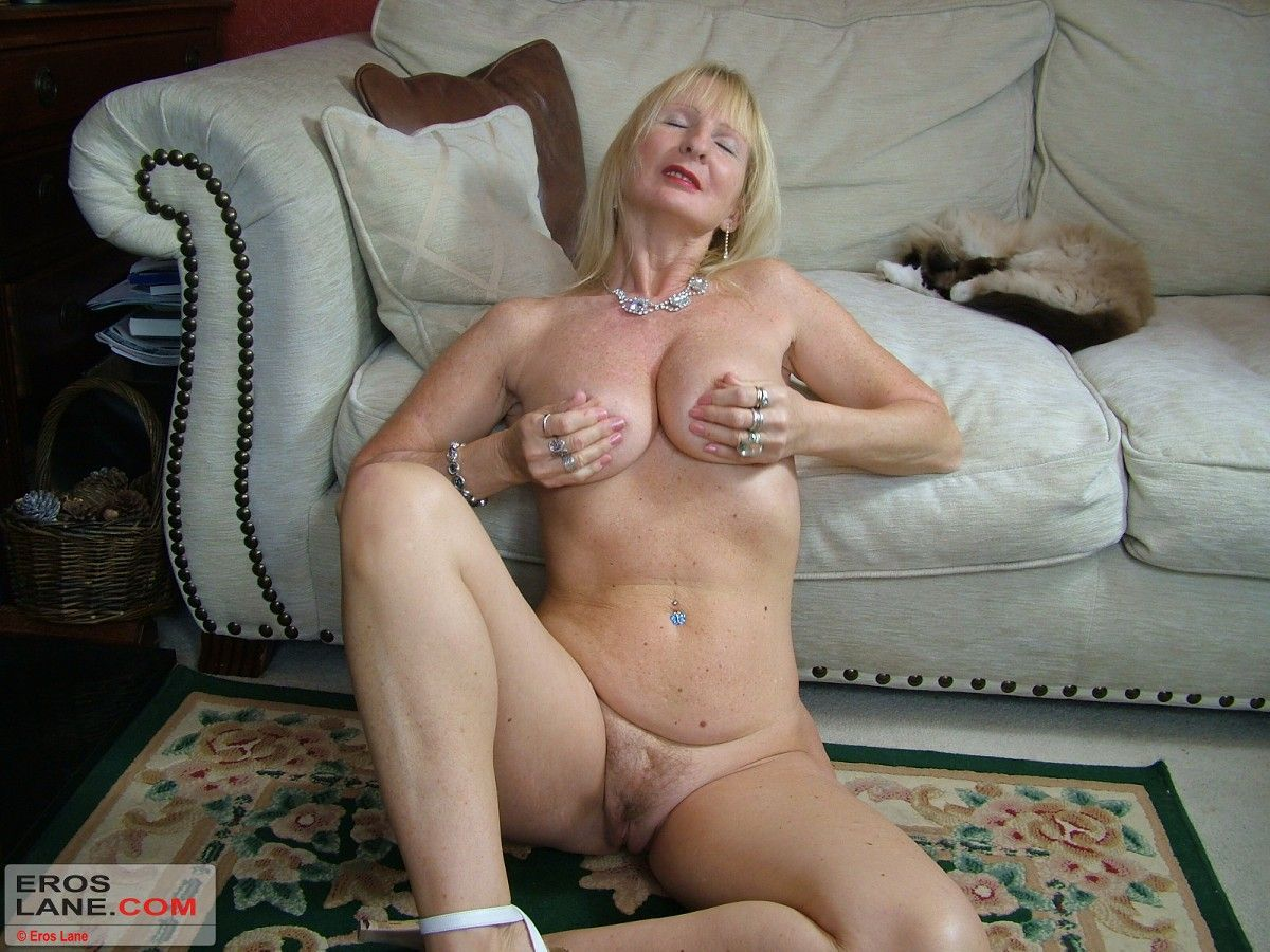 A woman holding several male sex free video